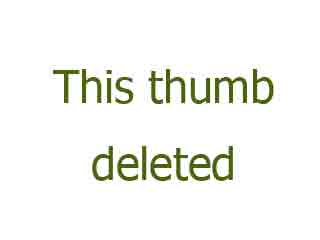 Mistress wearing black latex catsuit uses strapon on slave.